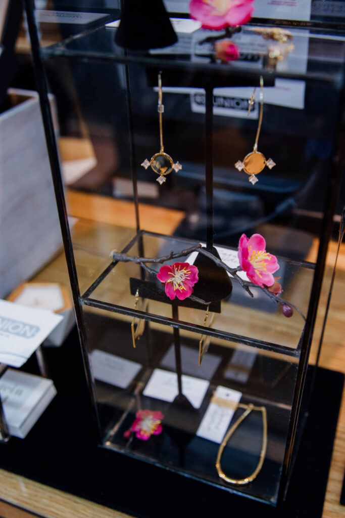 Gold earrings on display in a boutique in Victoria, BC.