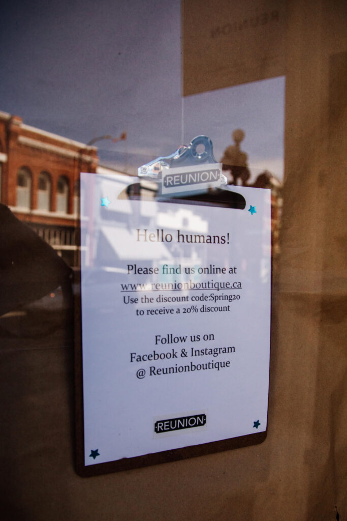 A sign showing how to connect to a store via social media during COVID-19 pandemic.