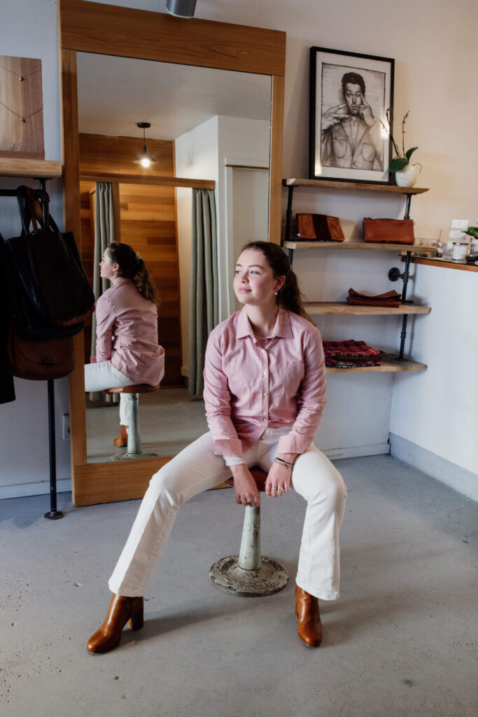 A model sitting on a stool in a clothing shop in Victoria, Canada.