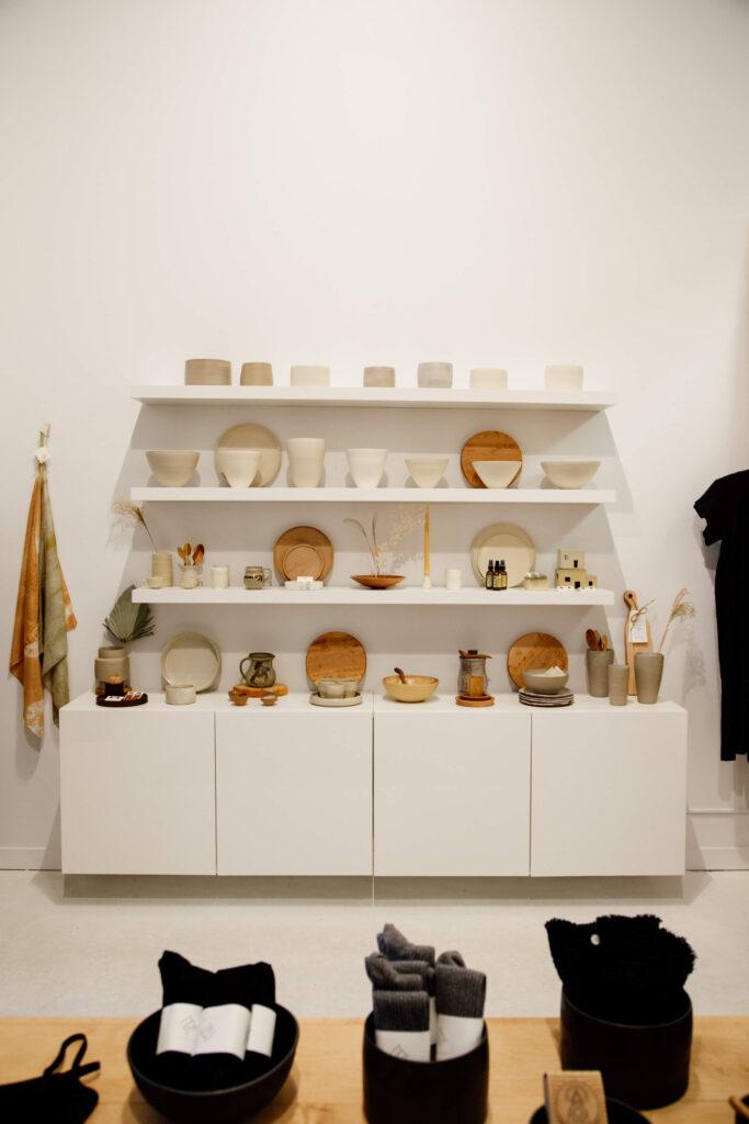 Ceramics displayed on a shelf.