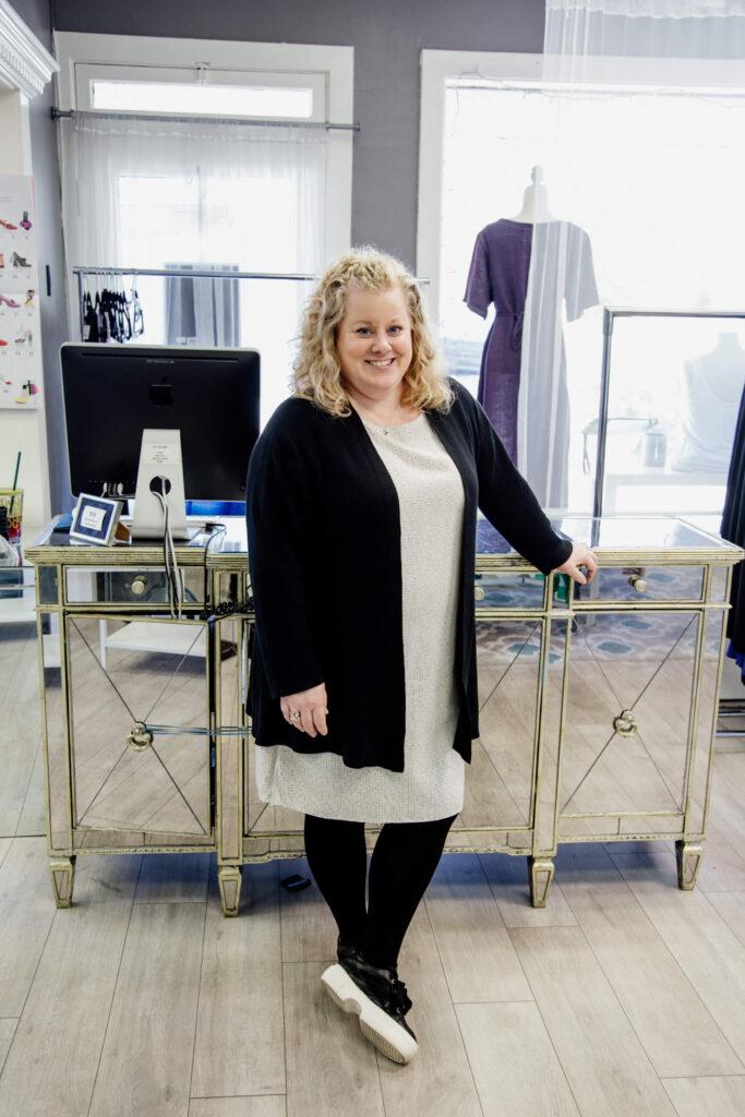Shop owner standing in front of her desk
