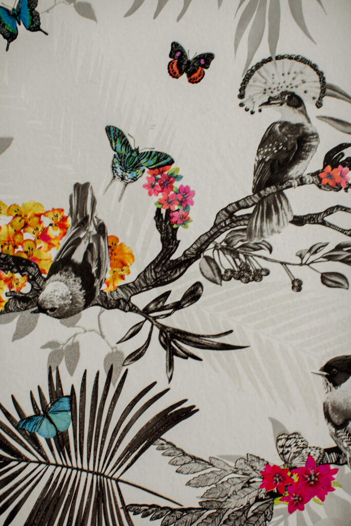 Colourful birds and leaves wallpaper.