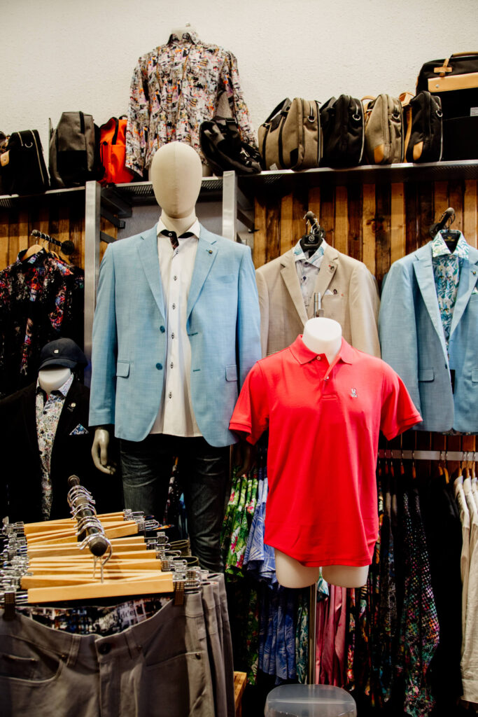 Jackets and shirts on display in a shop in Victoria, BC.