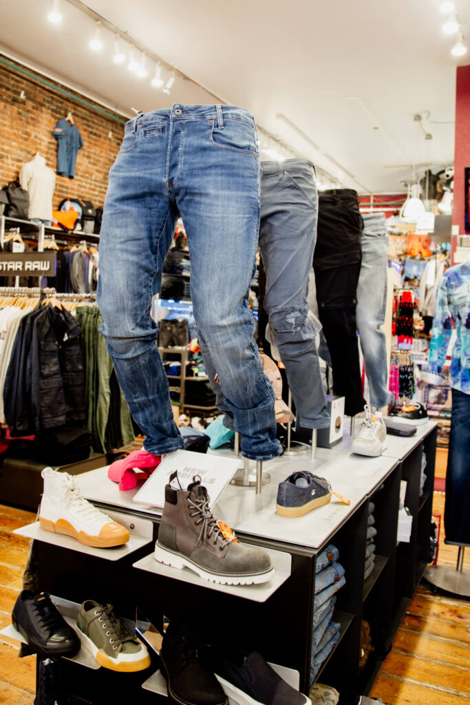 Jeans and boots on display in a fashion shop in Victoria, BC.