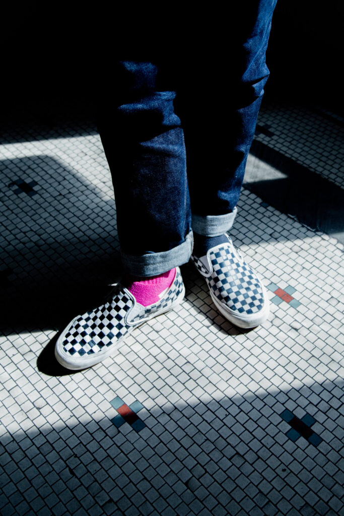 Checkered shoes on a checkered tile floor.