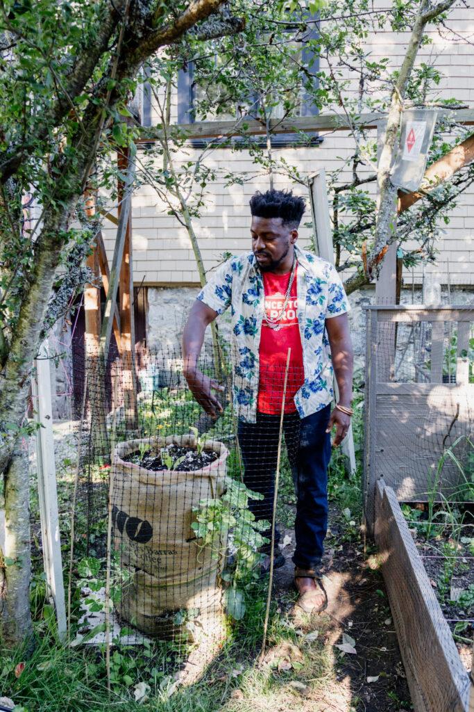 A man explains his burlap sack garden in Victoria, BC.