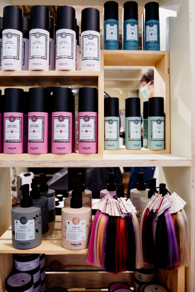 Hair products on a shelf.