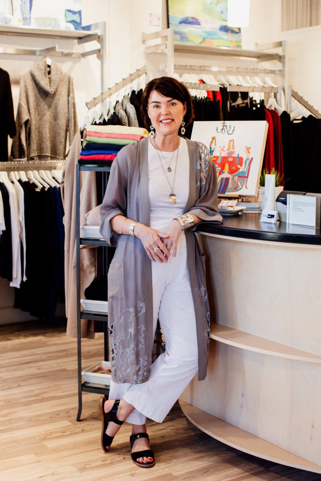 The owner of Tulipe Noire, a clothing store in Victoria, BC, stands inside her shop.
