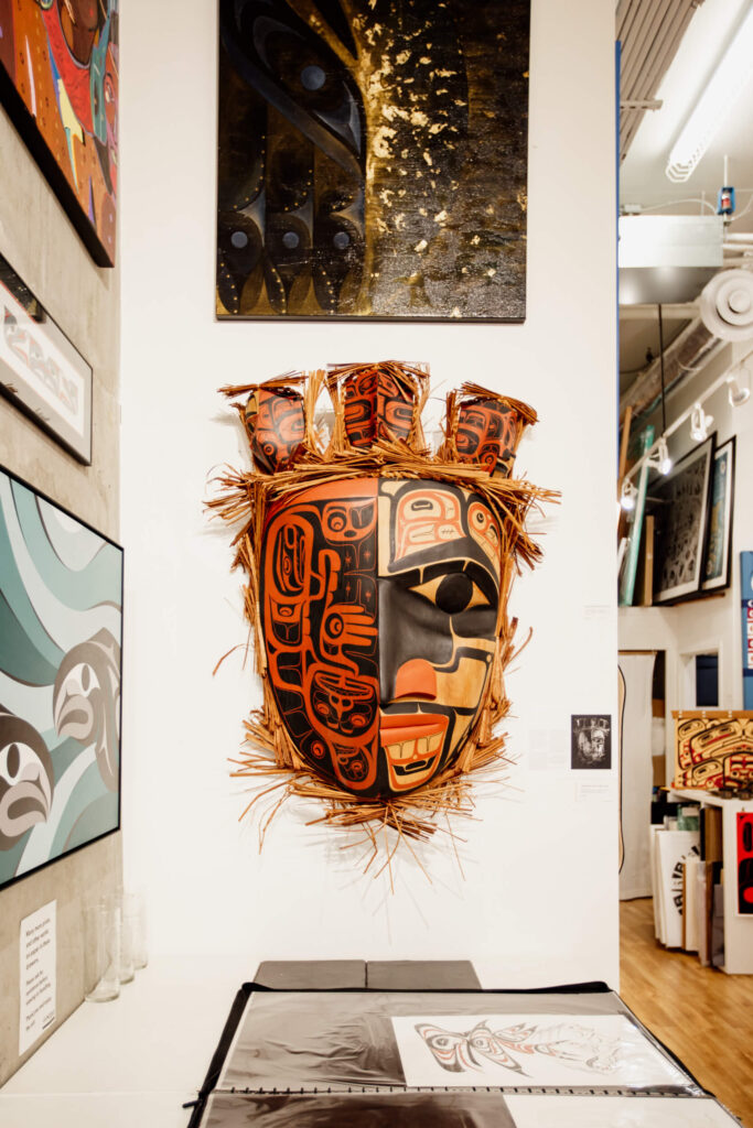 Mask on the walls in an Indigenous art gallery in Victoria, BC.