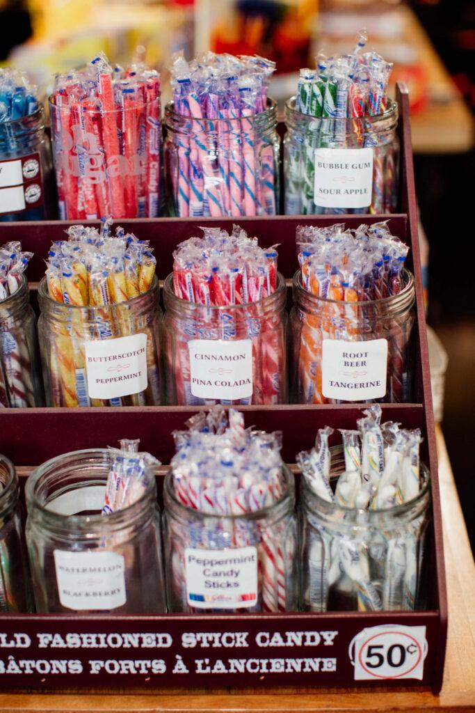 Candy sticks in a jar in a candy store.