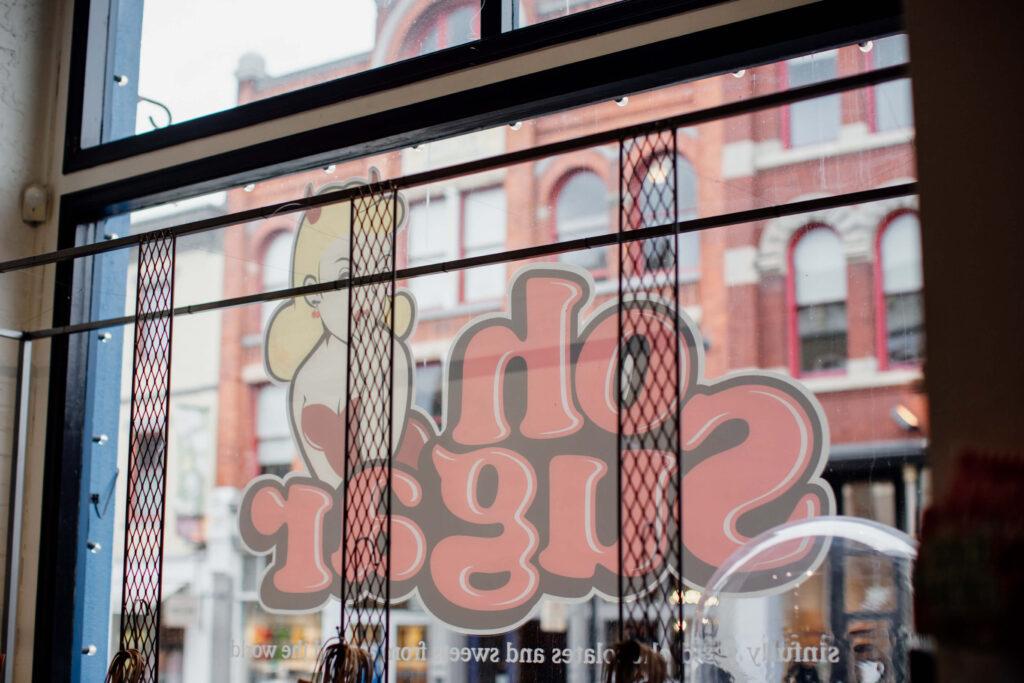 The logo on a shop window.